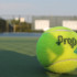 Tennis ball sits on West's practice field.