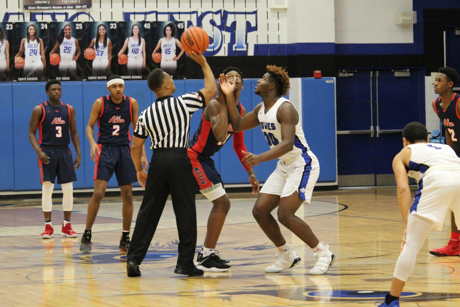 Plano West's Shemar Pearl (#30) looks to get to ball off the tip off at the beginning of the game.