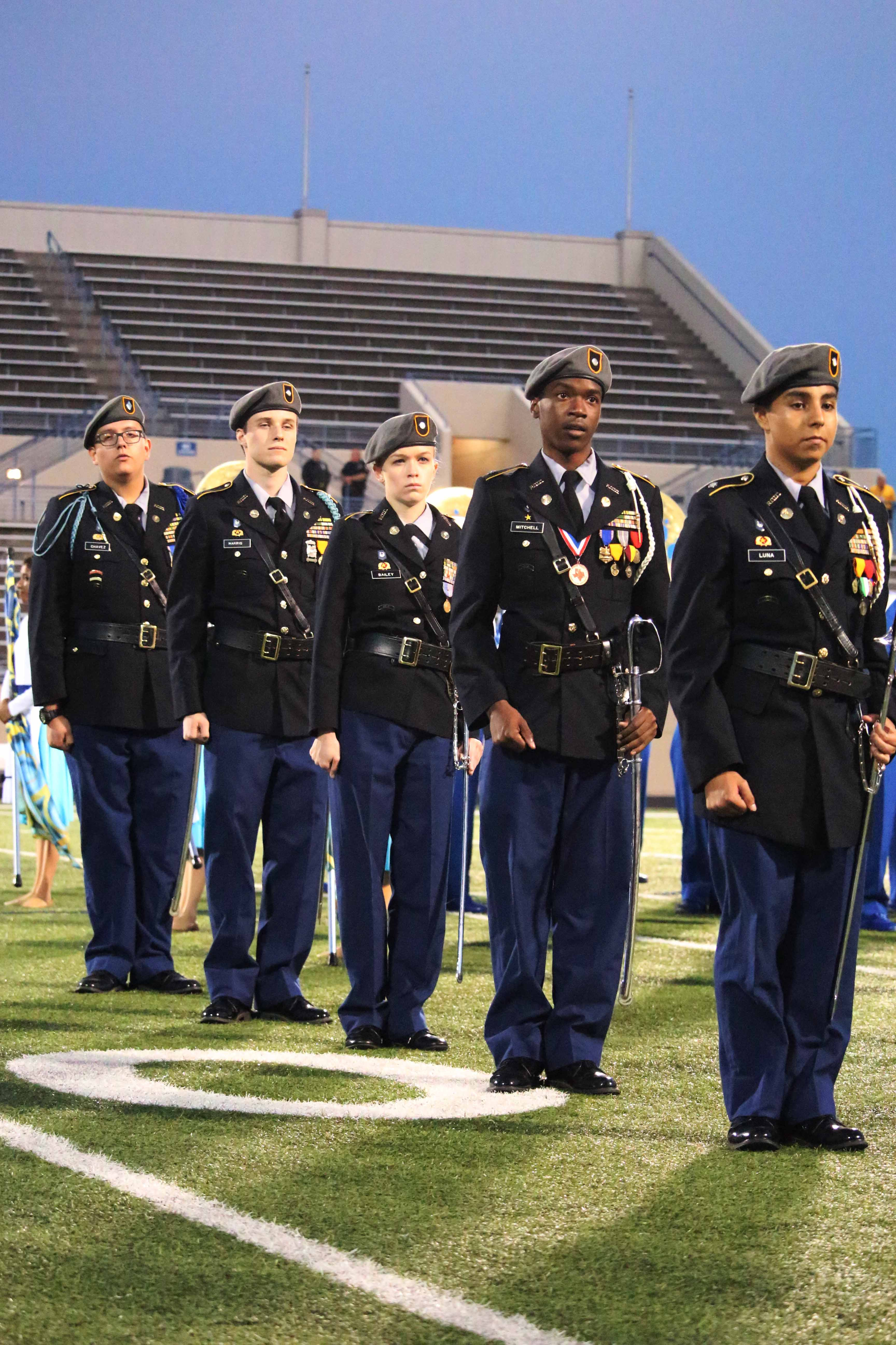 Lining up at the Homecoming game, students in JROTC stand tall.