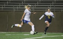 Sophomore defender Ellie Lemaster guards the ball from a McKinney player.
