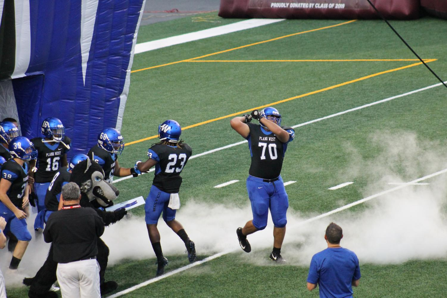 Offensive lineman Michael Balis (#70) drops the hammer to bring West out of the tunnel against Mesquite.