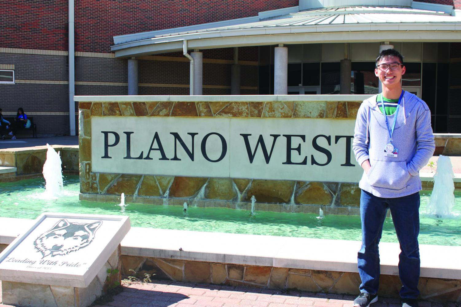 Newly elected Junior Class President (JCP) Michael Lam poses for a photo in front of the Plano West fountain.